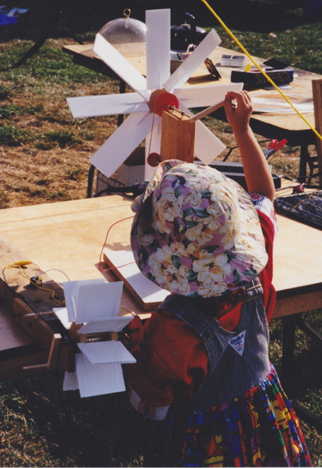 Child playing with renewable energy kit