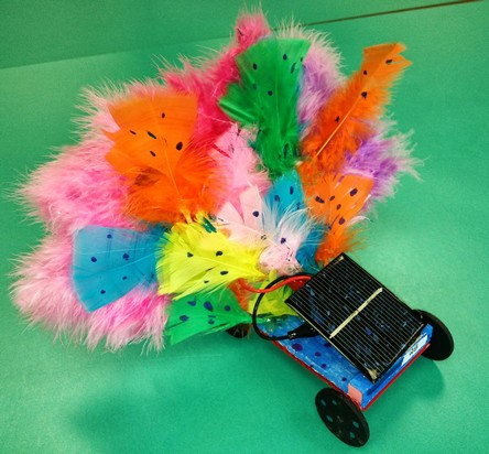 solar toy car built with feathers