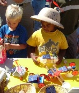 picture os two young boys at Saturday market selling solar car kits